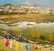 Landscape with tibetan monastery and lake