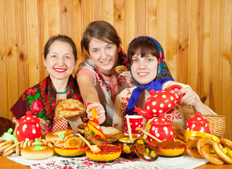 Women  eating pancake during  Shrovetide