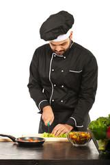 Chef man cutting vegetables