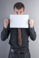 young handsome businessman with blank card