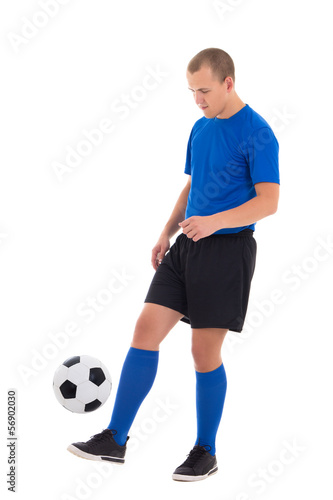 attractive soccer player in blue uniform playing with ball isola