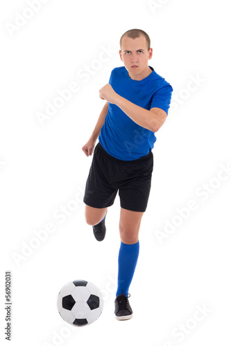 young attractive soccer player in blue kicking ball isolated on