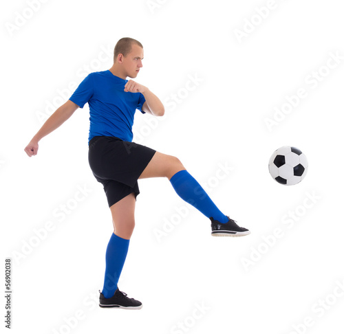 profile view of soccer player in blue kicking ball isolated on w