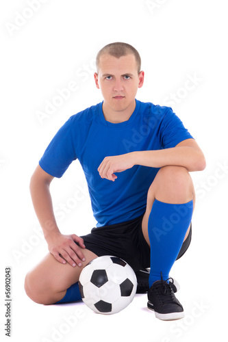 soccer player in blue sitting with ball isolated on white backgr