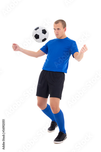 soccer player in blue stop the ball with his chest isolated on w