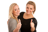 Two beautiful women gesturing success