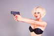 attractive blond girl with a gun