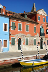 channel with boats on the island of Burano, Venice, Italy
