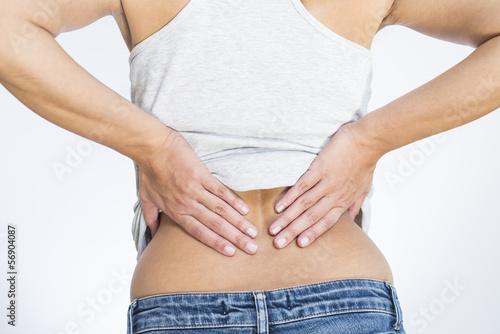 Leinwanddruck Bild Frau mit Schmerzen im Lendwirbelbereich