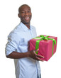 Handsome african guy with a christmas gift
