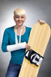 Woman with broken arm and snowboard