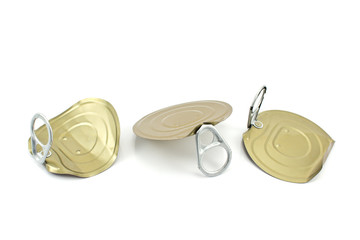 Three tin can lids with opener isolated on white