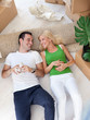 couple relaxing in new house