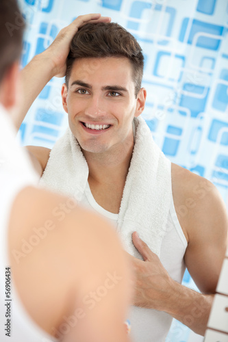 Reflection of young man in mirror