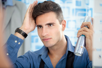 Man applying hair spray