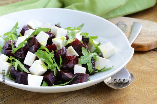 salad with beetroot and soft feta cheese and arugula