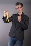Young businessman holds a banana peel