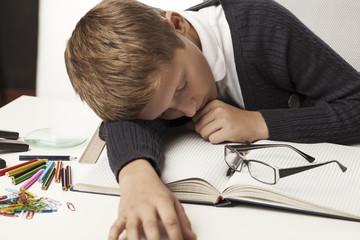 boy fell asleep on textbooks