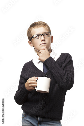 boy thinking with a mug