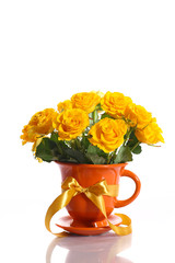 yellow roses in a pot