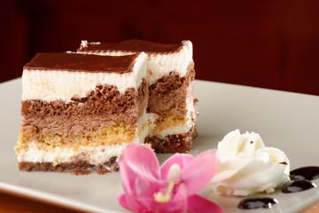 chocolate cream cake on white plate