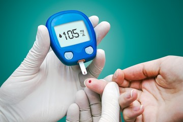 Doctor making blood sugar test