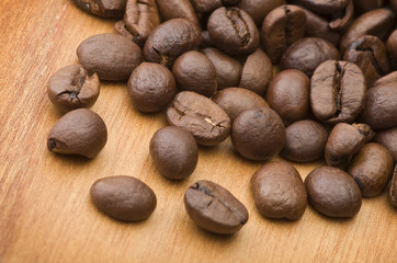 Coffee beans close up on the wood table