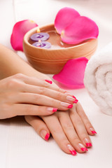 pink manicure with fragrant rose petals