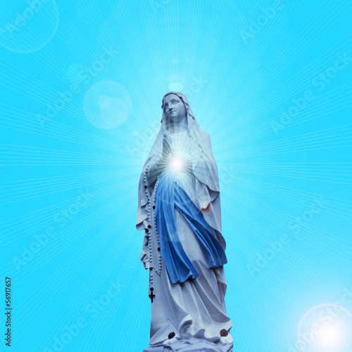 Madonna statue with blue sky background Canvas