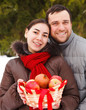 Happy young couple in the winter park