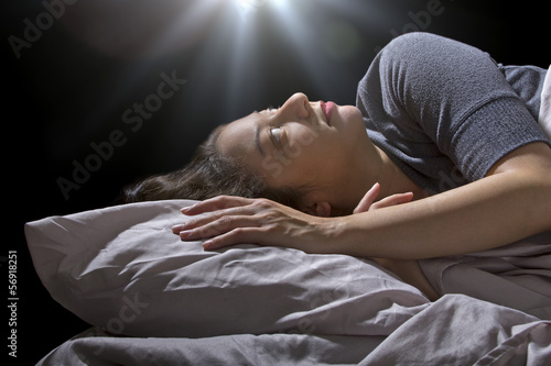 creepy glowing orb hovering over a woman sleeping in bed Poster