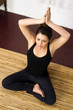 Comfortable Attractive Woman Sits Lotus Style Yoga Position