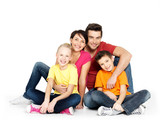 happy  family with two children sitting on white floor