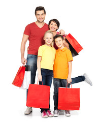 family with shopping bags standing at studio