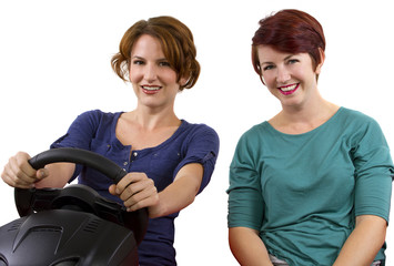 two young female driving on a road trip with white background