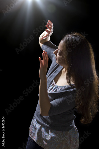 young woman seeing bright glowing orbs from above