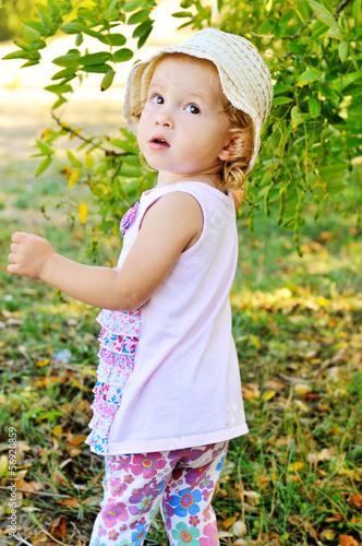 toddler girl in green garden