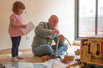 Man with child repairing furniture