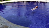 beautiful woman swims in pool