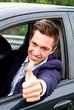 Happy man in his new car