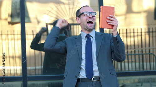 Successful businessman with tablet computer in the city