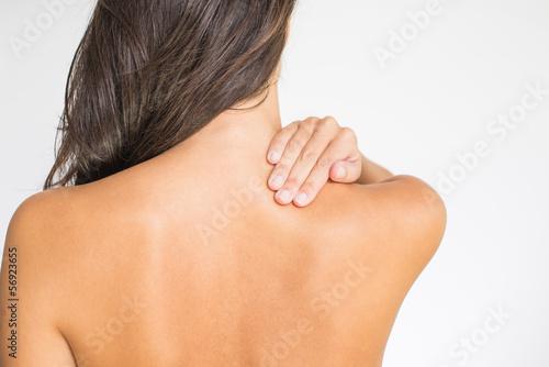 Leinwanddruck Bild Frau mit Schmerzen im oberen Rücken und im Nacken