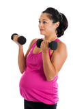 Fit Hispanic pregnant woman doing bicep curls