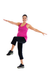 Healthy Hispanic pregnant woman doing low impact aerobics