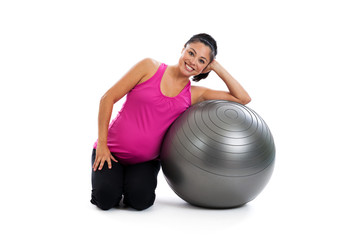 Healthy pregnant Hispantic woman with exercise ball isolated