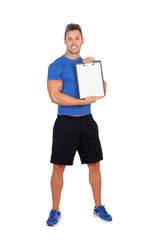 Handsome personal trainer with clipboard