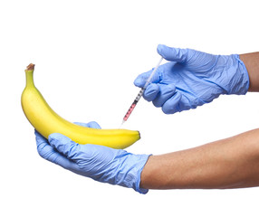 Injection into banana isolated. GMO fruit and syringe