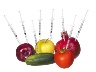 GMO food and syringes isolated. Concept. Genetic injections