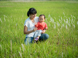 mom baby grass field