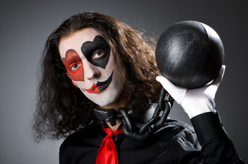 Clown with shackles in studio